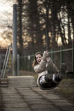 Young woman having fun on a swing Royalty Free Stock Photography