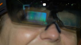 A young woman having fun testing the augmented reality glasses. stock video