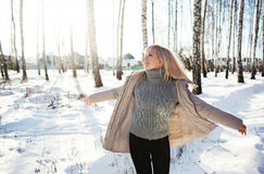 Young woman having fun in the winter forest Royalty Free Stock Photos