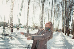 Young woman having fun in the winter forest Stock Images
