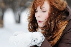 Young woman having fun in winter. Outdoors portrait of young beautiful woman having fun in winter Stock Image