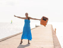Young woman having fun on wooden pier Stock Photo