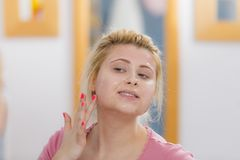 Young woman having gel mask on face Royalty Free Stock Image