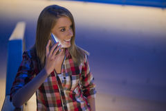 Young woman is having good news at the smartphone Royalty Free Stock Photography