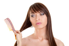 Young woman having hair combed Stock Photo