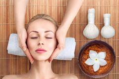 Young woman relaxing with massage in spa Royalty Free Stock Photo