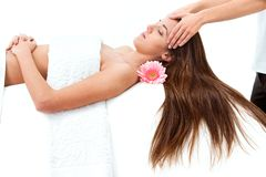 Young woman having head massage. Royalty Free Stock Photography