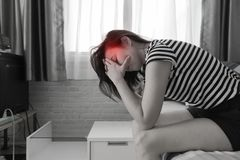 Young woman having a headache on bed. royalty free stock image