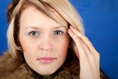 Young woman having a headache close up Royalty Free Stock Photos