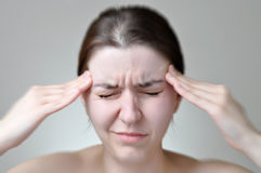 Young woman having headache Stock Image