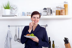 Young woman having a healthy breakfast in her kitchen Stock Photography