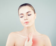 Young Woman having Heartache. Woman Puts Hands. On the Chest on Grey Background Stock Photos