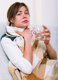 Young woman having heavy sickly tonsillitis Royalty Free Stock Image