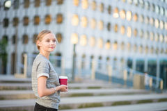 Young woman having her coffee break Royalty Free Stock Photography