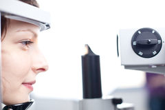 Young woman having her eyes examined Royalty Free Stock Photo