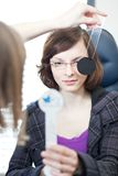 Young woman having her eyes examined Royalty Free Stock Images