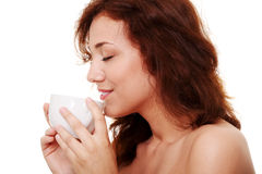 Young woman is having her tea/coffee Royalty Free Stock Photo