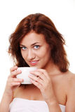 Young woman is having her tea/coffee Royalty Free Stock Photos