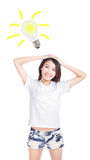 Young woman having an idea with light bulb Royalty Free Stock Image