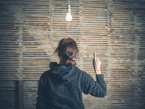 Young woman having idea under light bulb Royalty Free Stock Photography