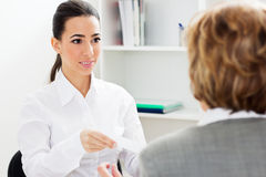 Young woman having an interview Stock Image