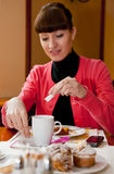Young woman having lunch Royalty Free Stock Photography