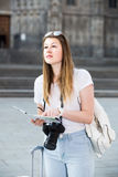 Young  woman having  map and looking for her route in the city Stock Photos
