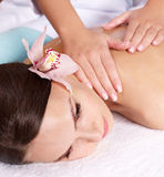 Young woman having massage. Stock Photos