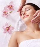 Young woman having massage. Stock Photos