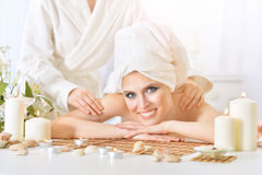 Young woman having massage Stock Photos