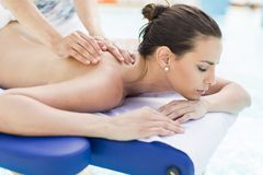 Young woman having massage Stock Image
