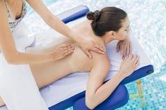 Young woman having massage Stock Photos