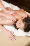 Young woman having a massage Royalty Free Stock Photography