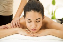 Young woman having a massage Royalty Free Stock Photos