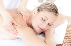 Young woman having a massage in a spa center Royalty Free Stock Images