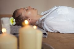 Young woman having massage treatment in spa Royalty Free Stock Photo