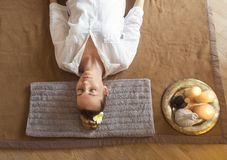 Young woman having massage treatment in spa. Close up Stock Image