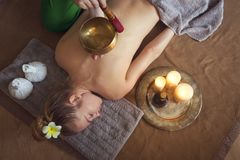 Young woman having massage treatment Royalty Free Stock Photography