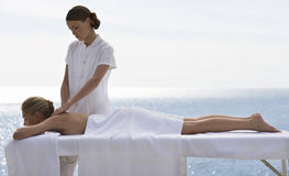 A young woman having a massage Stock Photography