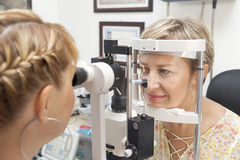 Young woman is having a medical examination at the optometrist Royalty Free Stock Images