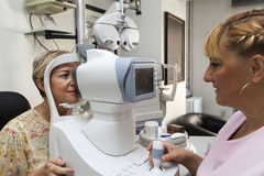 Young woman is having a medical examination at the optometrist Stock Photo