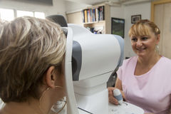Young woman is having a medical examination at the optometrist Royalty Free Stock Photography