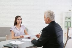Young woman having meeting with lawyer