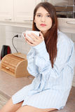 Young woman having morning coffee Stock Images