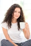 Young woman having morning coffee or tea Royalty Free Stock Image
