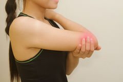 Young woman having pain in her elbow Stock Photos