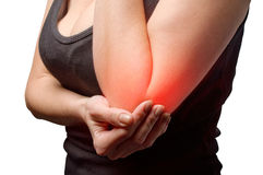 Young woman having pain in her elbow Stock Photo