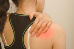 Young woman having pain in her shoulder Stock Photography