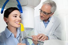 Young woman having panoramic digital X-ray with a the dentist Stock Image