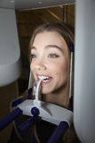 Young Woman Having Panoramic Digital X-ray Of Her Teeth Stock Images